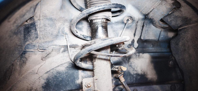 Обломанная пружина переднего амортизатора Додж Калибр
